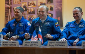 Astronaut Mike Hopkins of NASA, a flight engineer, Cosmonaut Oleg Kotov, Soyuz Commander and Cosmonaut Sergey Ryanzanskiy, Flight Engineer with the Russian Federal Space Agency. Photo courtesy of NASA