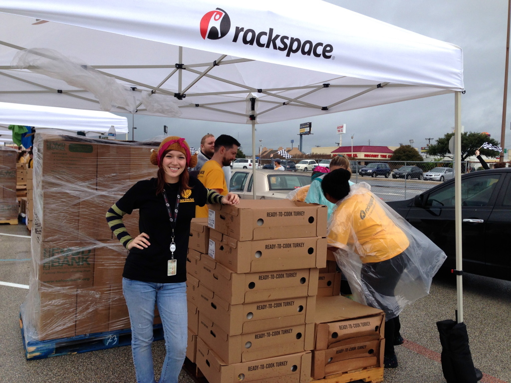 Allie Howard with Rackspace, wearing a turkey hat, and getting into the spirit of the Thanksgiving Day Food Drive