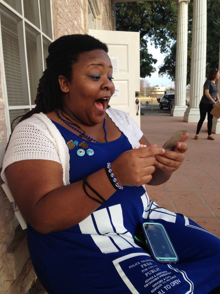 Amanda Saunders from Houston reacts to getting a rare card  in  the Ingress game