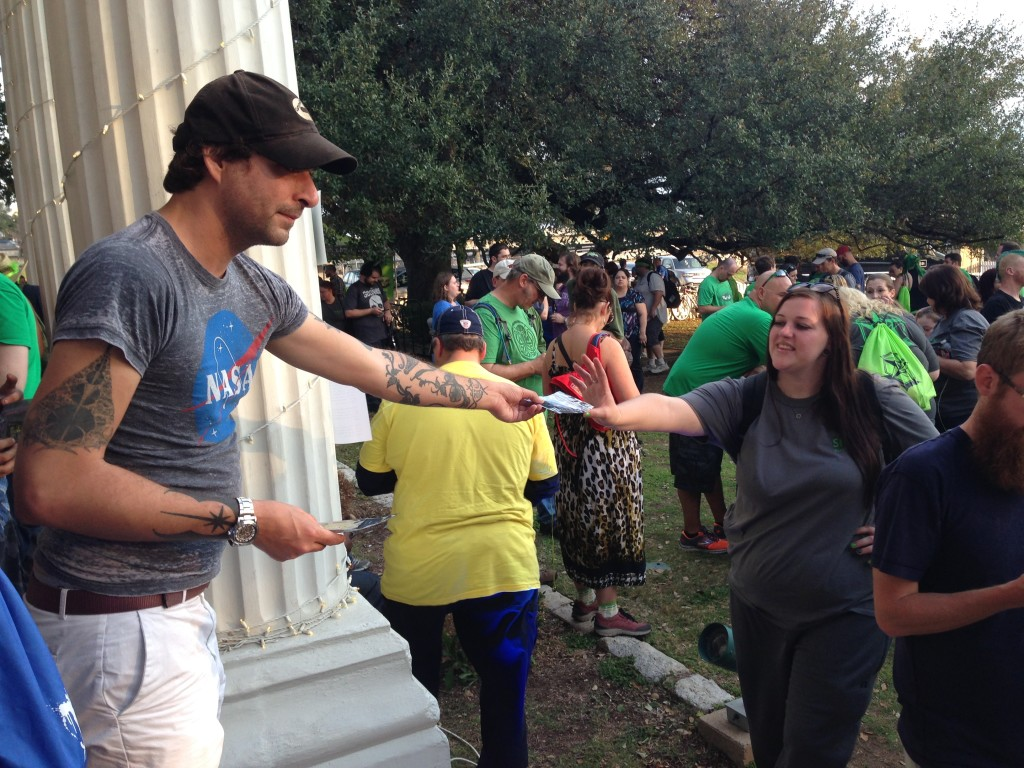 A Niantic Labs representative hands out patches to Ingress Shonin Anomaly  players
