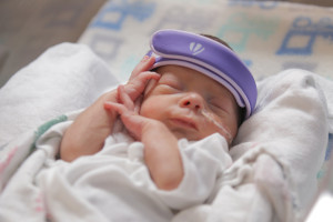 Newborn at Baylor Medical wearing one of Invictus Medical's GELShield devices, courtesy photo