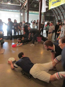 Teams playing human powered Hungry-Hungry Hippos, the mystery event