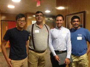 """(Second from the left) Benito Fernandez, associate professor in the department of mechanical engineering, presented """"CHECK,"""" a chaotic hybrid encryption communications kit. Pictured with his students."""